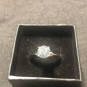 Large CZ solitaire diamond on rhodiummplated band